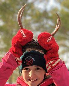 Photo of Macoun Club member Samantha posing with deer antlers