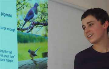 Photo of Gabriel McMurren with pictures of New Zealand birds