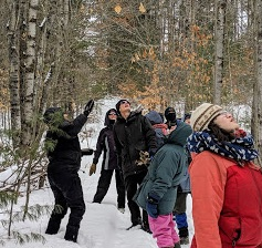 Photo of Macoun Club group in snowy forest