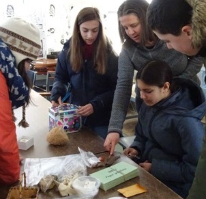Photo of Macoun Club members assembling nature-quiz materials