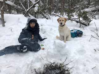 Photo of Macoun Club member and his dog at campfire