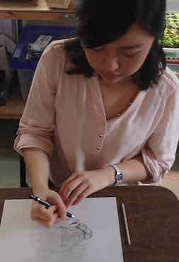 Photo of Jessica Hsiung making a drawing