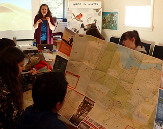 Photo of Macoun Club leader Jen Line teaching map-reading skills