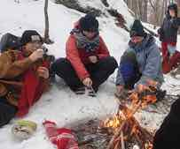 Photo of Macoun Club members at winter lunch fire