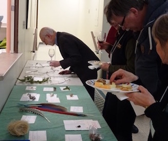 Photo of ONFC members scrutinizing Macoun Club nature-quiz objects on a table