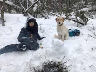 Photo of Macoun Club member and his dog at campfire
