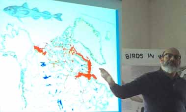 Photo of Noel Alfonso with graphic showing range of the Arctic Cod in the north