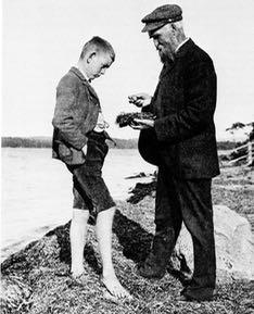 Photo of John Macoun discussing bird nest with barefoot boy
