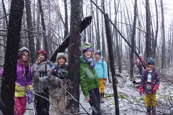 Photo of Macoun Club members in a burned-out forest the year after a forest fire in Ottawa's greenbelt