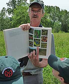 Photo of Peter Hall with Macoun Club members in the Fletcher Wildlife Garden butterfly meadow