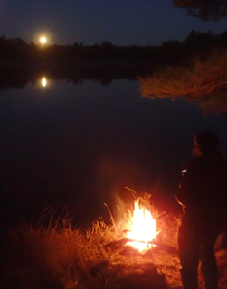 Photo of moonrise over a Macoun Club campfire